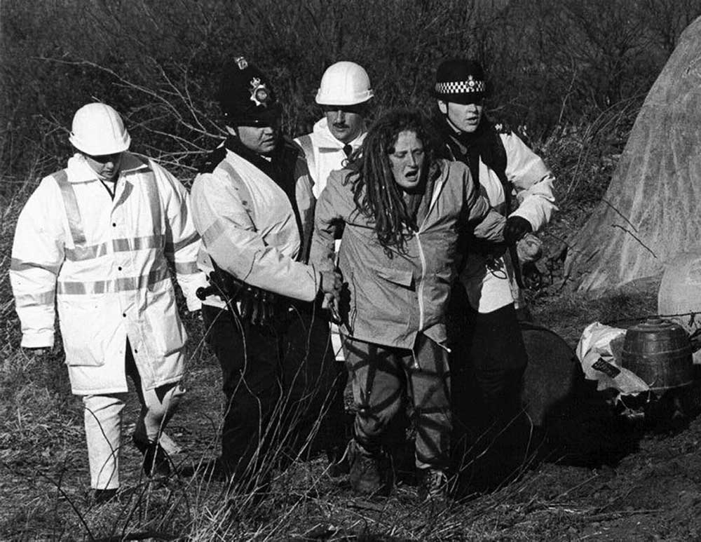 An activist is led away after an eviction at Brewery Fields, North Wales.